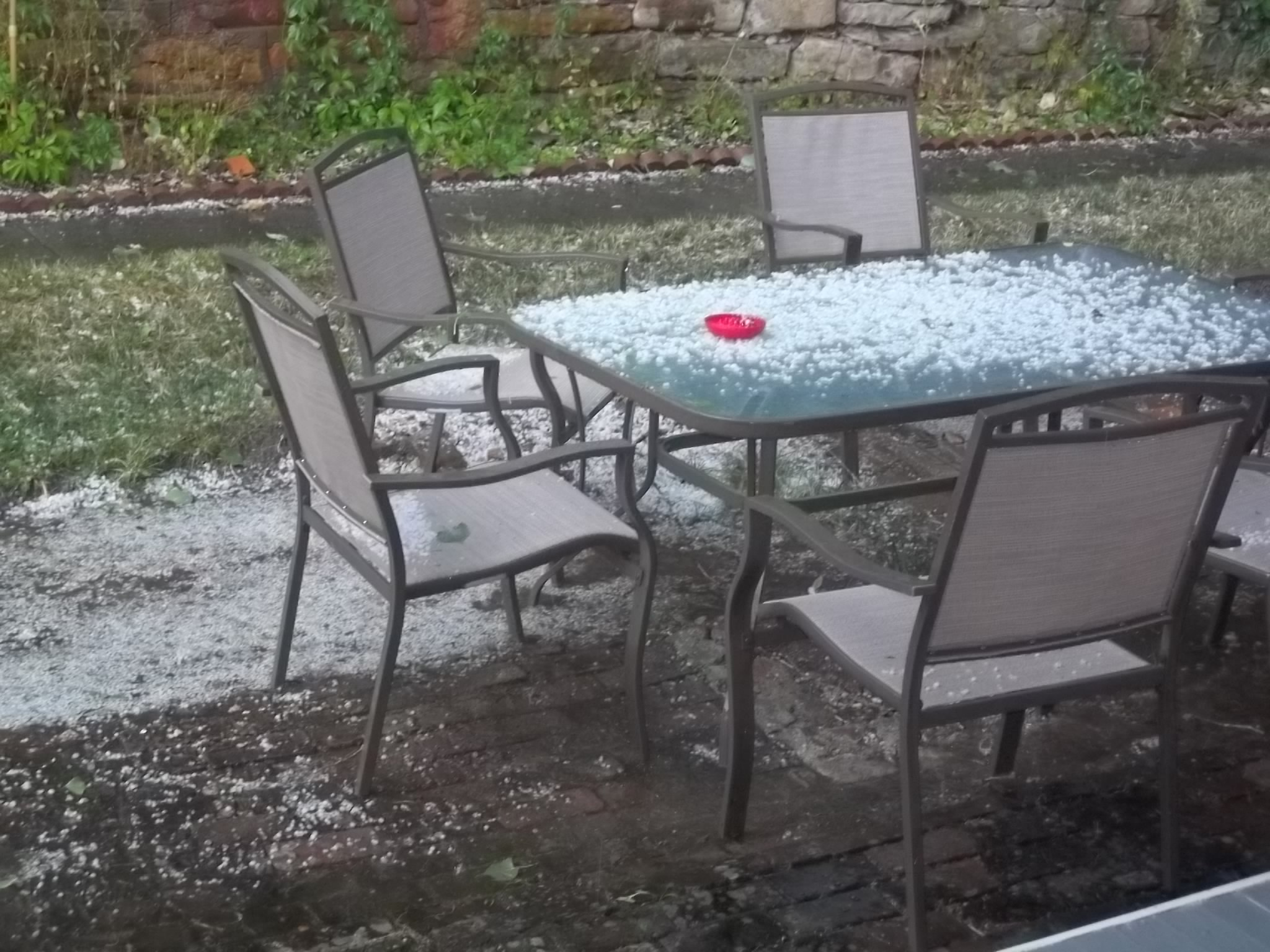 This hail fell down 20 minutes after the sun was out 110% and melted after the sun came right back out. Weird, huh? Go figure South Dakota.