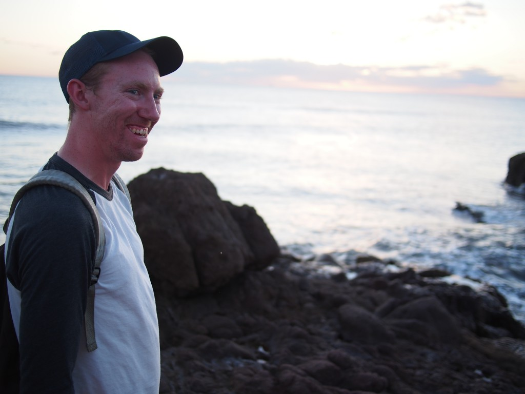 Ian, wearing my self-proclaimed dad hat, grinning off into the Pacific.