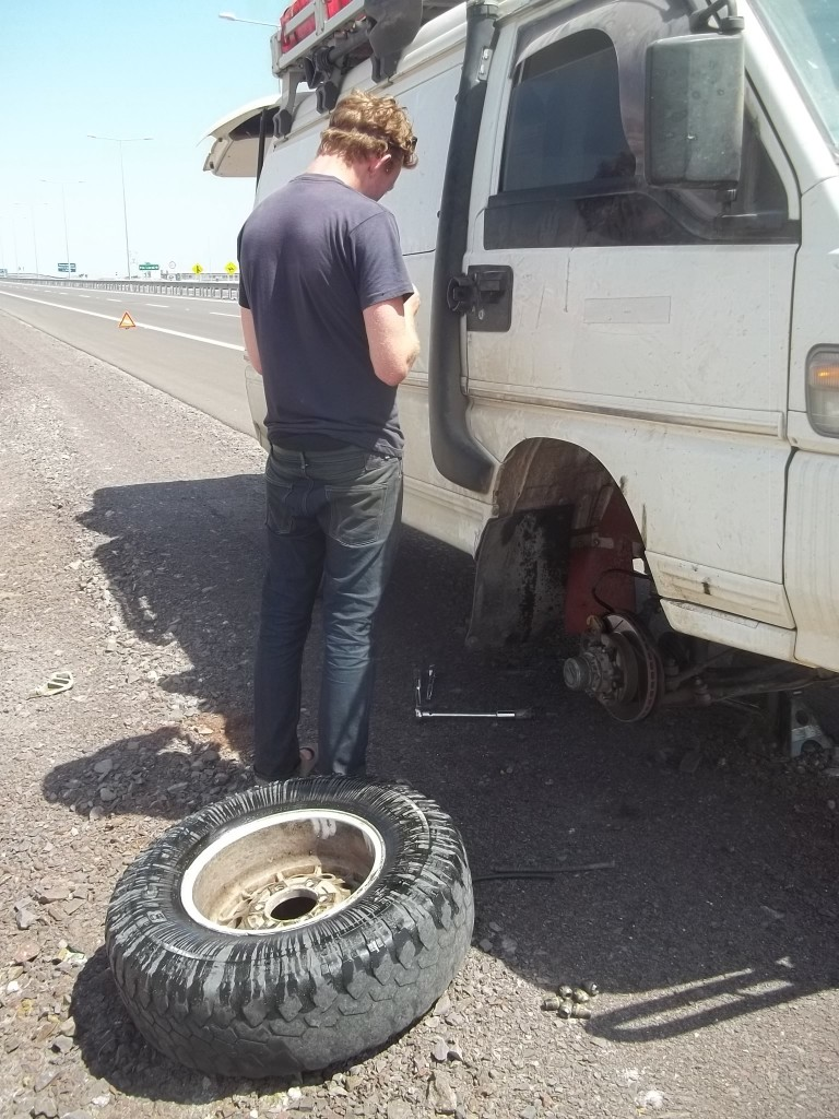 That's brake fluid all over the wheel...the cable, yesterday, had been replaced too close and ground down...